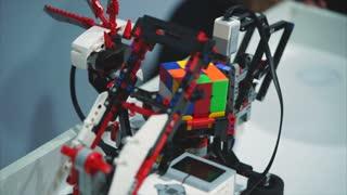 TOGLIATTI, RUSSIA - JULY 21, 2017: Lego technics robot solving a Rubik's Cube. In exhibition City of Robots in the Mall Park House.