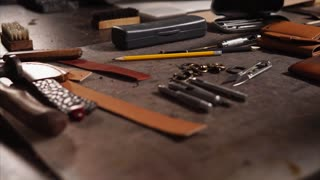 Tools on the table at the workshop of leather craftsman