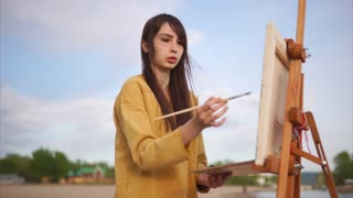 Woman painter working en plein air. She painting from nature in impressionism art style