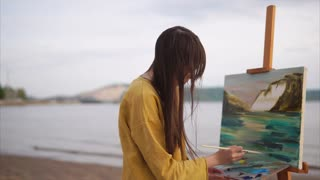 Woman painting oil picture with inspiration and passion. Creative person