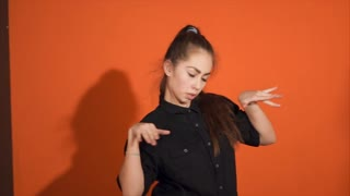 Young woman performing hip-hop dance in studio. Hip-hop culture. Expressive modern dance in motion. Slow motion.