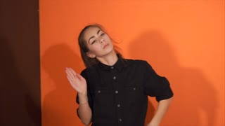 Young woman performing hip-hop dance in studio. Hip-hop culture. Slow motion.