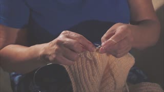 Woman hands close up knitting