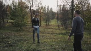 Young happy couple meet in the autumn park