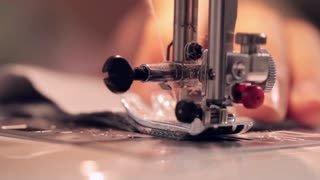 Close up footage of a woman sewing on sewing machine