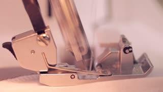 Close up on a sewing machine showing process. Macro
