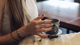 Female hands hold cup of coffee