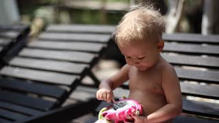 Little cute girl eats a dragon fruit outdoor