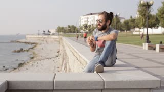 Man eating apple and looks at sea