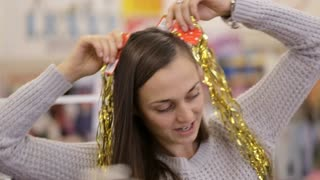 Mother and daughter having fun with decorate for xmas tree at supermarket.