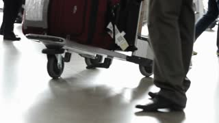 People with baggages walking at airport