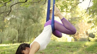 Practice of anti gravity fly yoga with hammock