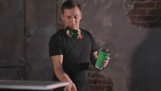 Bartender juggling bottles and shaking cocktail at a mobile bar