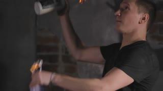 Bartender juggling bottles with fire at a mobile bar