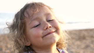 Close-up happy child face. Children in summer nature view at the beach, 4k