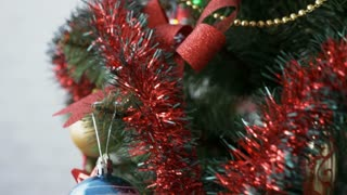 Decorated Christmas tree with toys and balls, close-up.