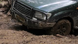 Expeditionary SUV got stuck in the mud in the forest, off-road