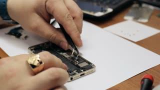 Male master repairing mobile phone