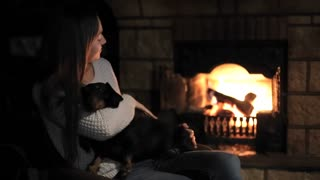 Nice woman hugging dog at home