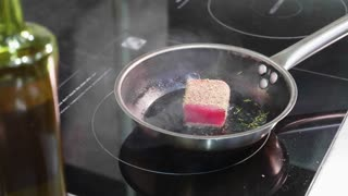 Pan-fried fish, The marlin fillet on the steaming frying pan.