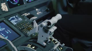 Panel of switches on an aircraft flight deck. Pilot controls the aircraft.