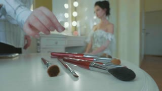 Preparation of a beautiful bride on the wedding day in slow motion.