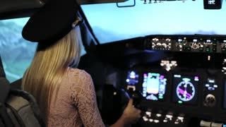 The Young blonde women controls the passenger plane