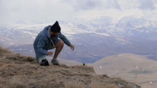 Traveler sets action camera for takes pictures of the mouintains landscape.