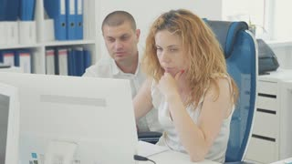 Young business people using computer in the office.