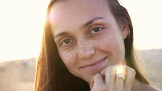 Young woman emotional face on the beach, close up portrait 4k slow motion