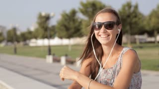 Young woman listen music and funny dancing
