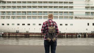 a Man With a Backpack Looking at Sea Liner