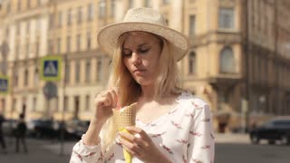 Beautiful Woman Eating Ice Cream on a Summer Day Outdoors