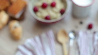 Breakfast of Porridge With Cherries and Pastry
