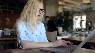 Business Woman Have a Headache, Working at a Laptop in a Cafe