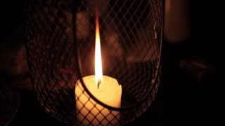 Candle in the Lantern is Lit in the Dark