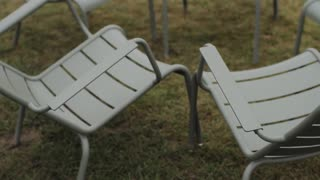 Circle of Chairs on Green Grass