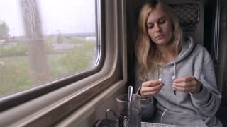 Girl Listening to Music With Headphones While Sitting by the Window in a Train