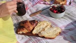 Girl Smears Jam on Croissant, Picnic