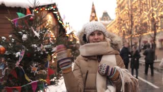 Girl Waves on a Christmas Market on the Red Square, Moscow