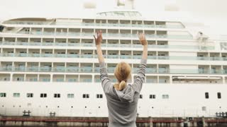 Girl Waving a Large Sea Liner Standing Back on Dry Land
