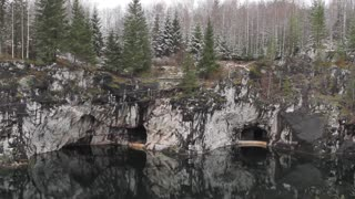 Karelia, Marble Canyon. Man Down on a Rope