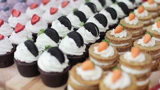 Many Varied Cupcakes on a Wooden Table