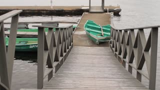 Pier at the Lake With Green Rowboat