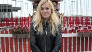 Portrait Girl Near the Red Carousel on the Street