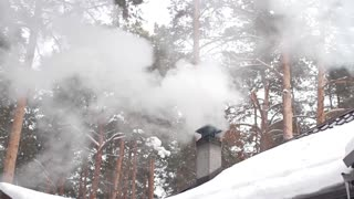 Smoke From the Chimney of House in the Winter Forest