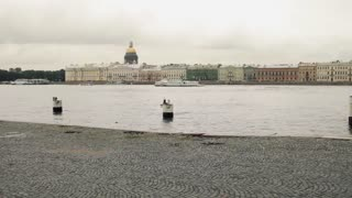 Sports Girl Runs Along the Waterfront of the City of St. Petersburg