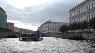 Tourist Boat Floats on the Review of St. Petersburg Channel