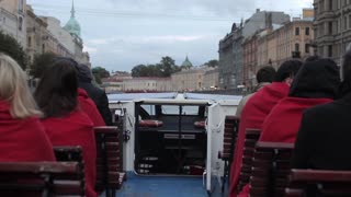 Tourists Float on a Boat Tour on the Canals of St. Petersburg