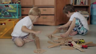 Two Brothers Playing in the Wooden Railroad House